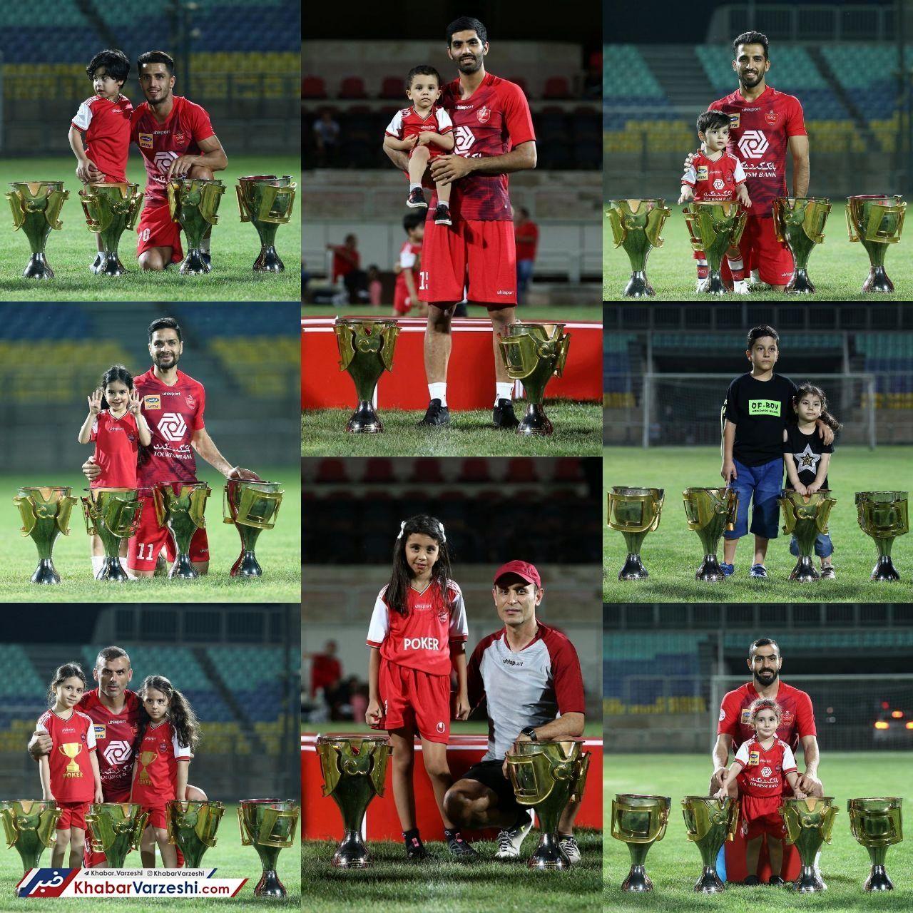 عکس یادگاری پرسپولیسیها به همراه فرزندانشان در کنار چهار جام قهرمانی